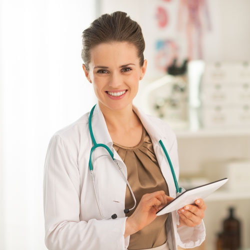 young female doctor holding an electronic tablet